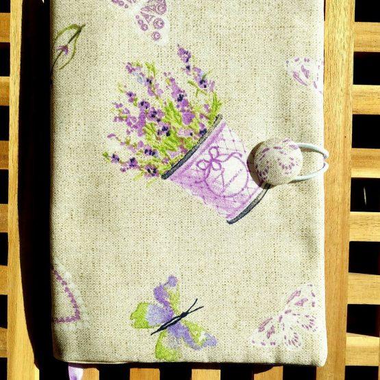 подвързия за книга - провансалски лавандули - лилави лавандули в кофичка на бежов фон със няколко светло лилави пеперудки наоколо